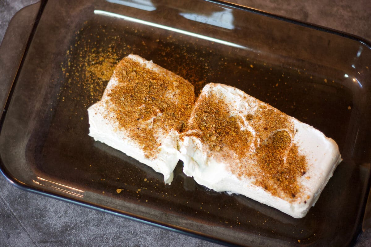 cream cheese and taco seasoning in a baking dish