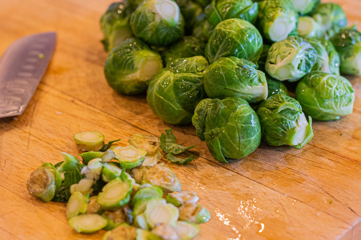 trimmed brussel sprouts on a cutting board