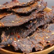 spicy game jerky in a bowl