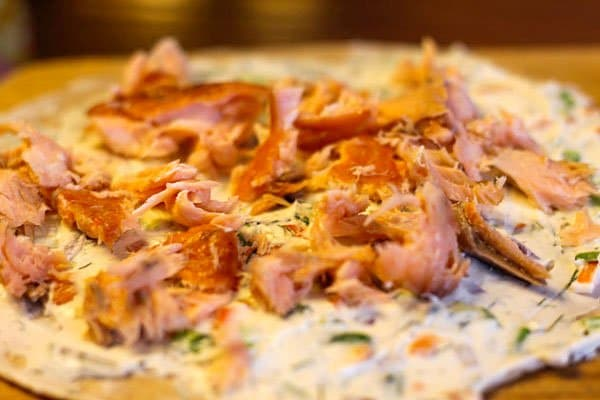 smoked salmon on a creeamcheese-covered tortilla