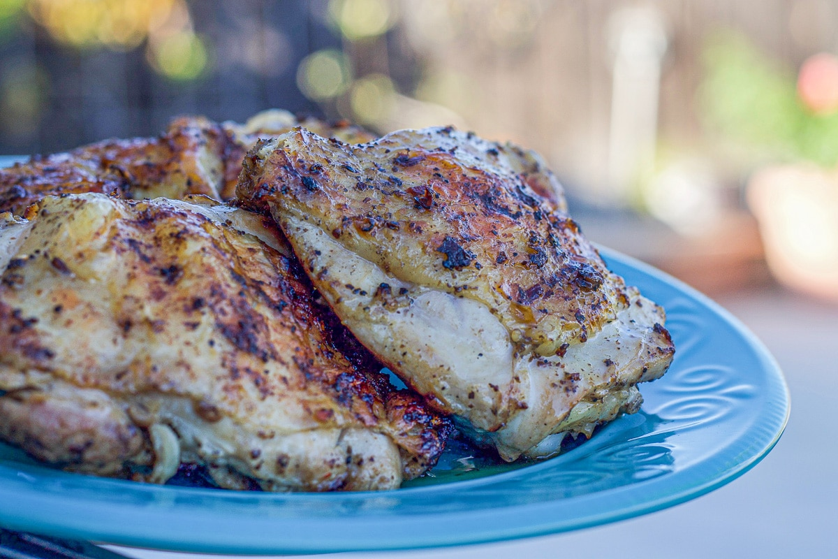 grilled sumac chicken on a blue plate