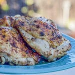 sumac chicken on a blue plate