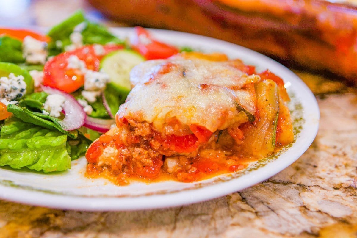 zucchini lasagna on a plate with salad