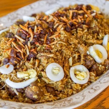 biryani plate with almonds, raisins, and sliced boiled eggs