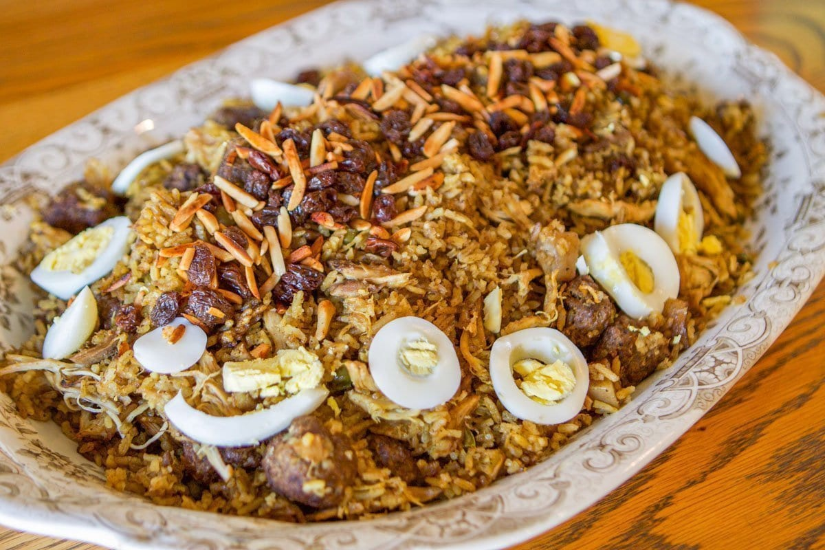 biryani plate with almonds, raisins, and sliced boiled eggs