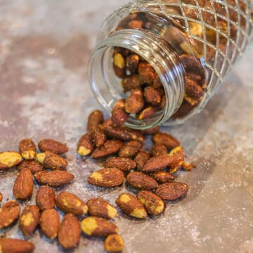 toasted almonds spilling from a jar