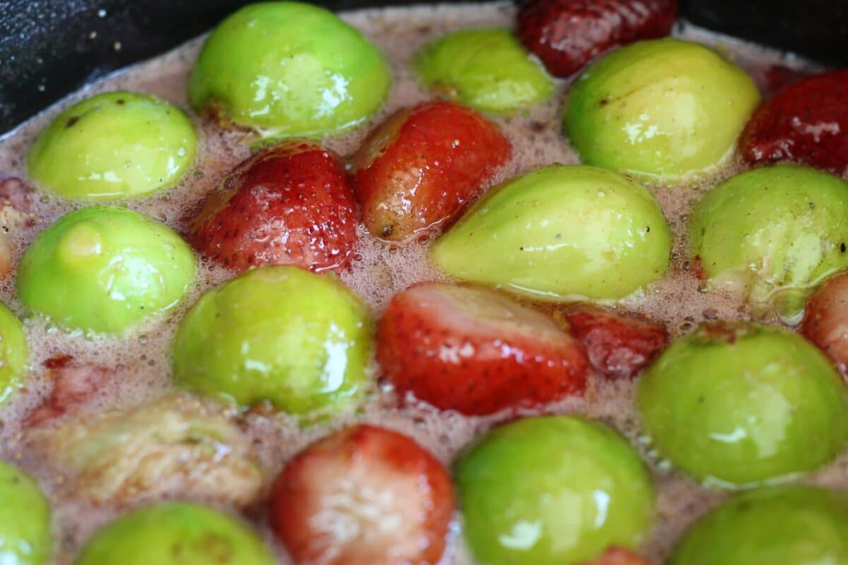 Strawberries and figs being boiled