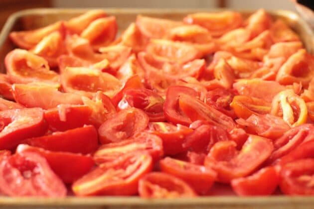 sliced tomatoes on a sheet pan