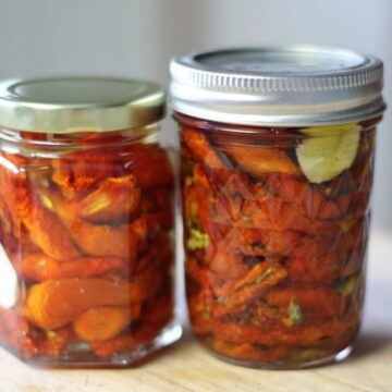 sun-dried tomatoes in 2 jars on the counter