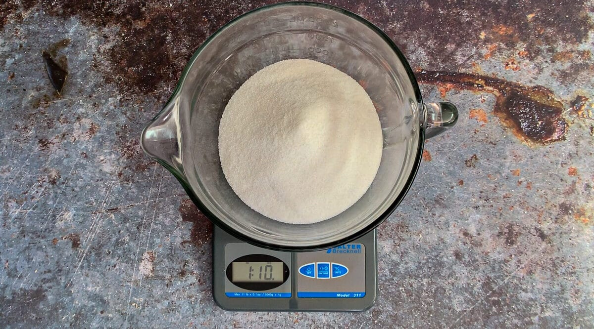 sugar on food scale being weighed