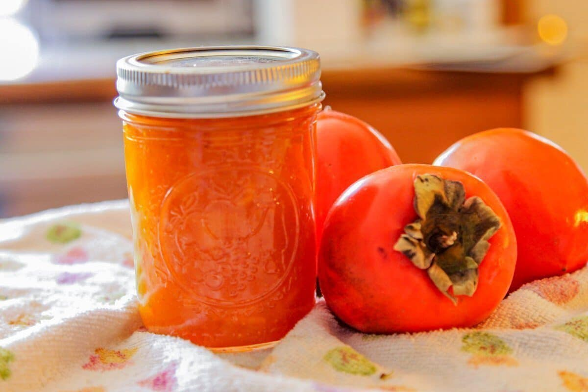 persimmon jam with a few persimmons on the side