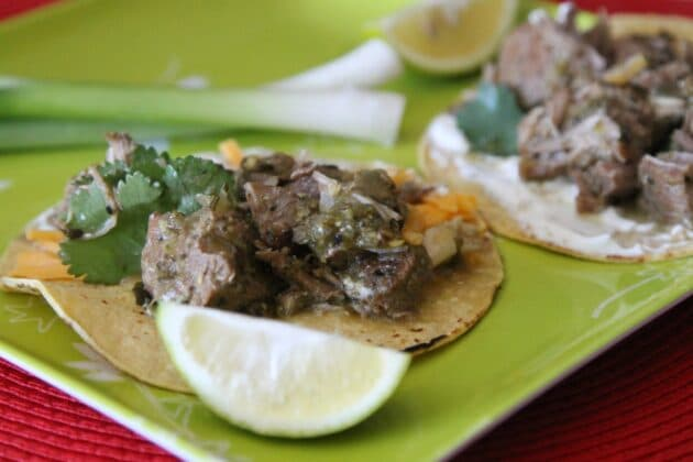 chili verde tacos on a green plate