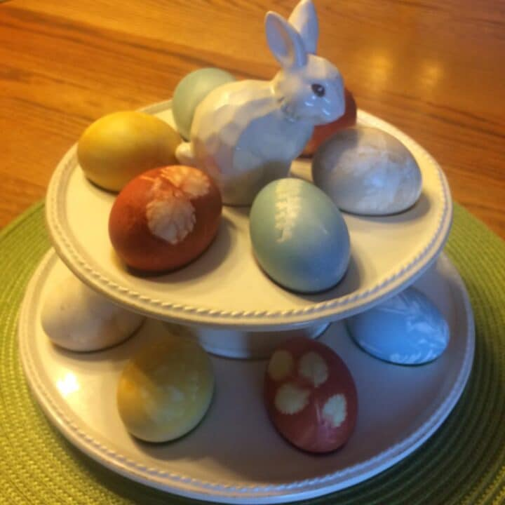 Easter eggs on a plate with bunny topper