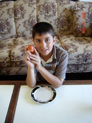 a little boy holding an Easter egg