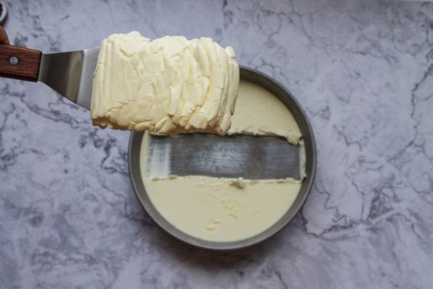 clotted cream being served in a pan on a gray marble top