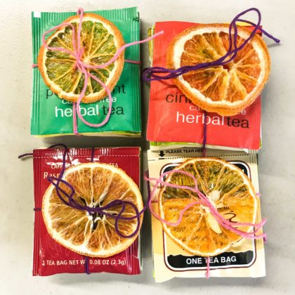 tea packets wrapped with orange slices