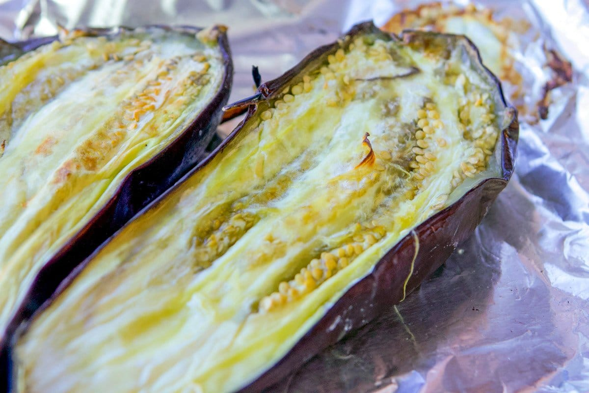 roasted eggplant on a foil-lined tray
