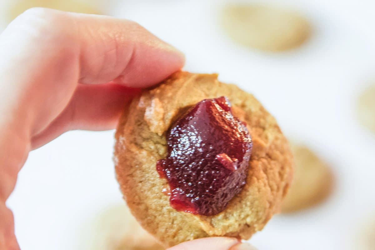 peanut butter cookie with raspberry jam in the center
