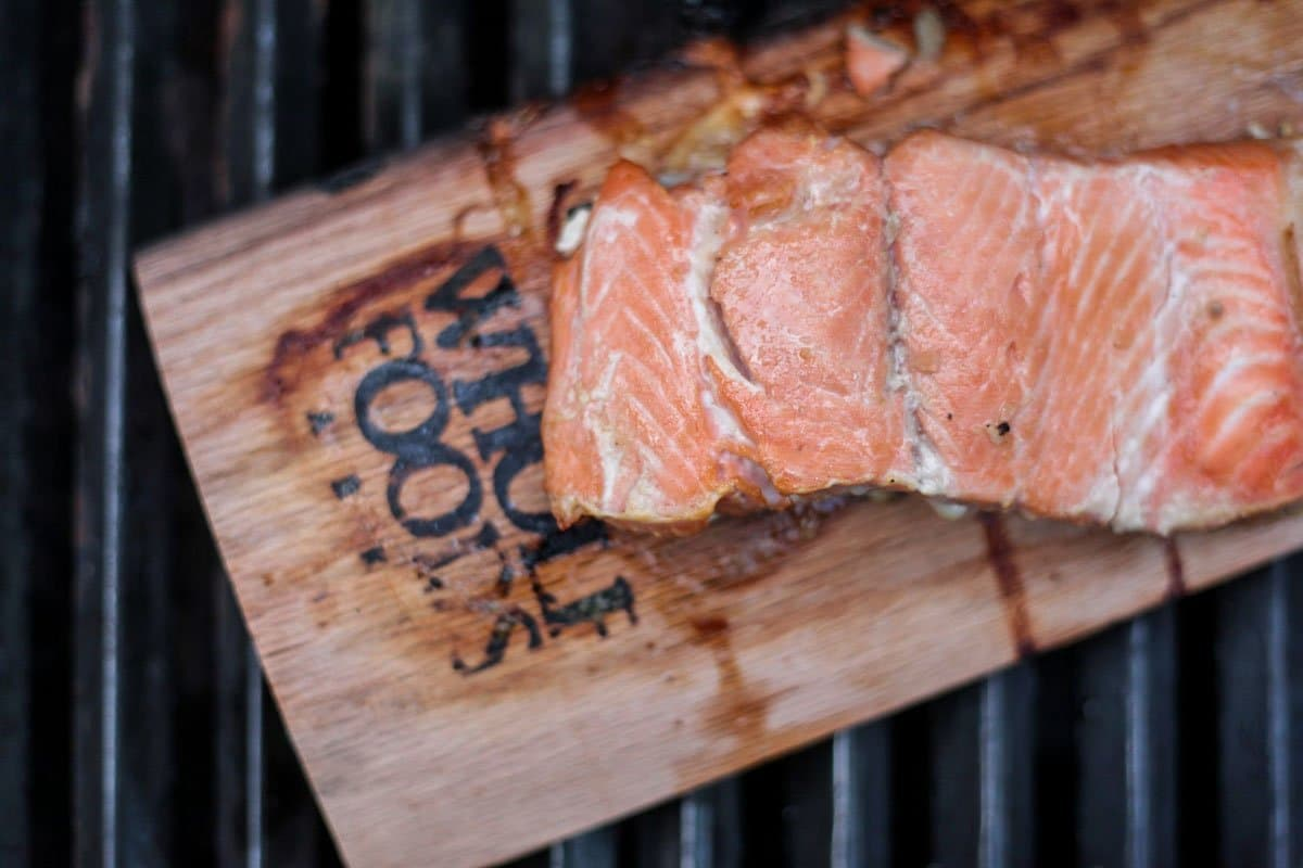 smoked salmon on a wooden slab