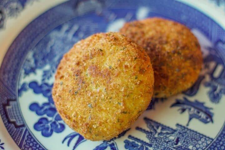 breaded potato patties (potato chops) on blue willow plate