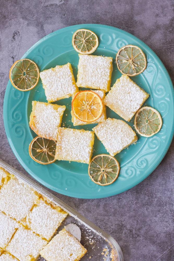 lemon bars on a blue plate