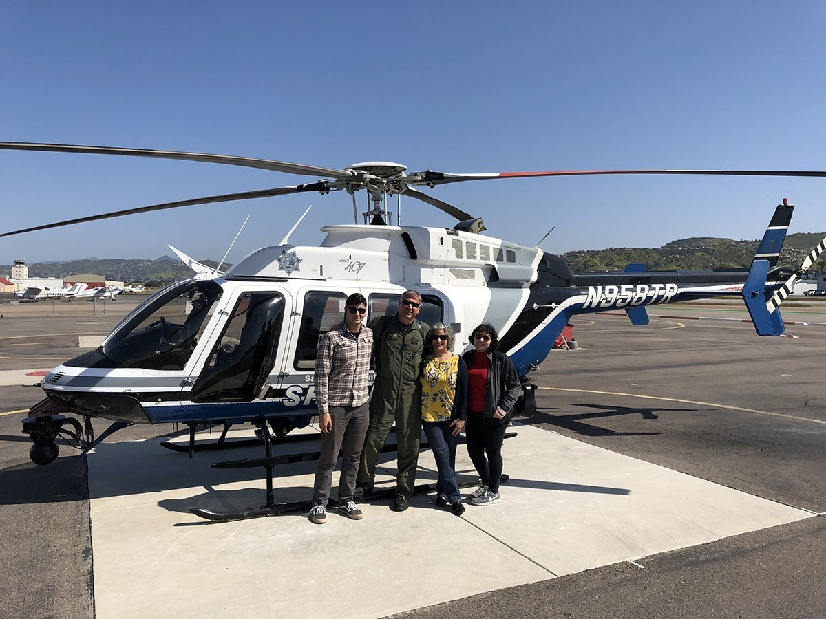family in front of a sheriff's helicopter