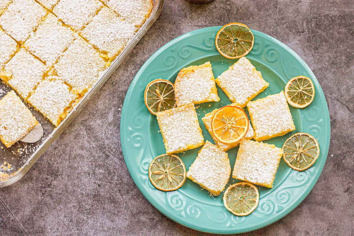 lemon bars on a blue dish
