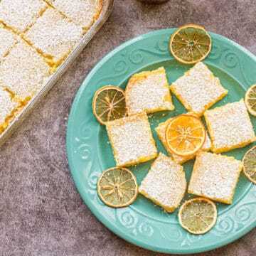 lemon bars on a blue dish