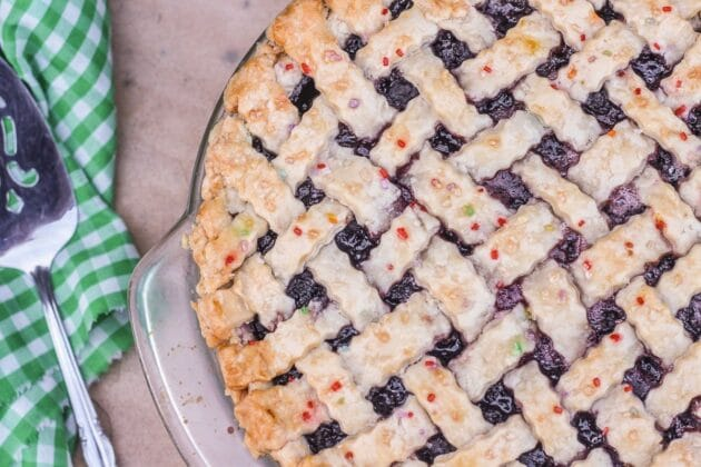 lattice top mulberry pie with a green and white napkin