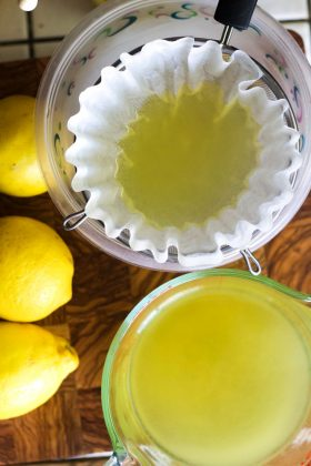 straining limoncello with coffee filter