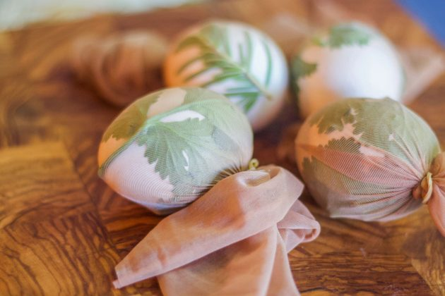 eggs covered with herbs and wrapped in nylons