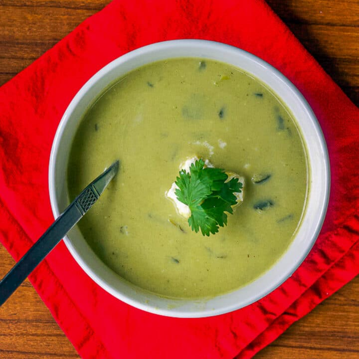 poblano soup on a red napkin