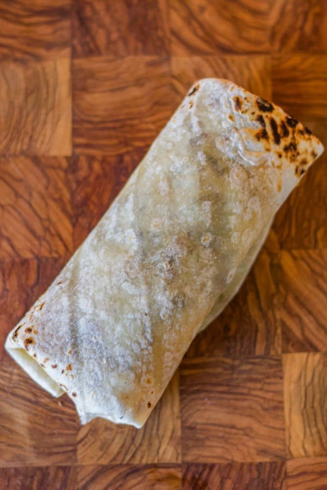 burrito on a wooden cutting board
