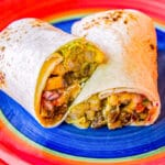 california burrito on a blue and red plate square