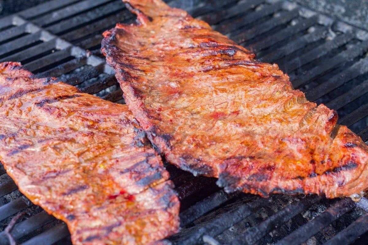 skirt steak carne asada being grilled