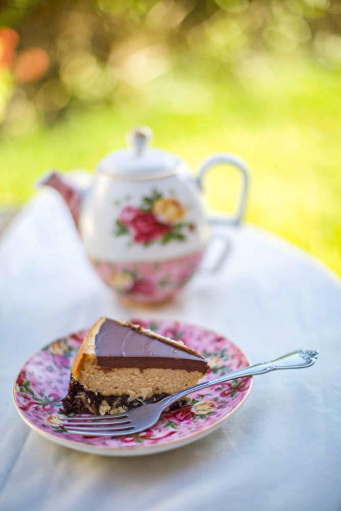 kahlua coffee cheesecake on a plate with a teapot