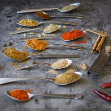 baharat spice blend in spoons on counter