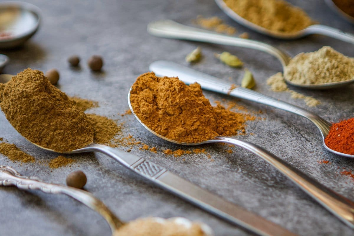 spoons with spices in them