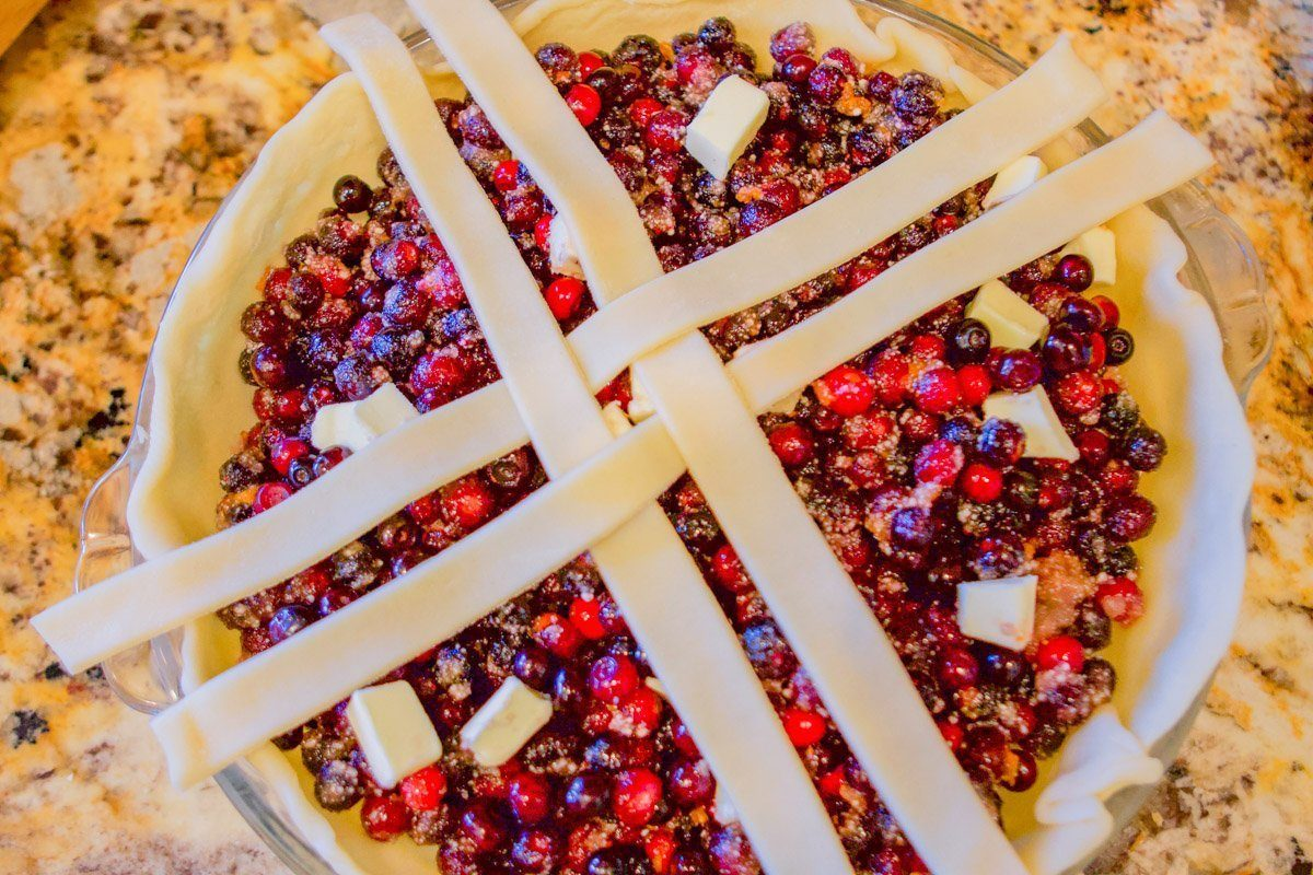 huckleberry pie with lattice strips over it