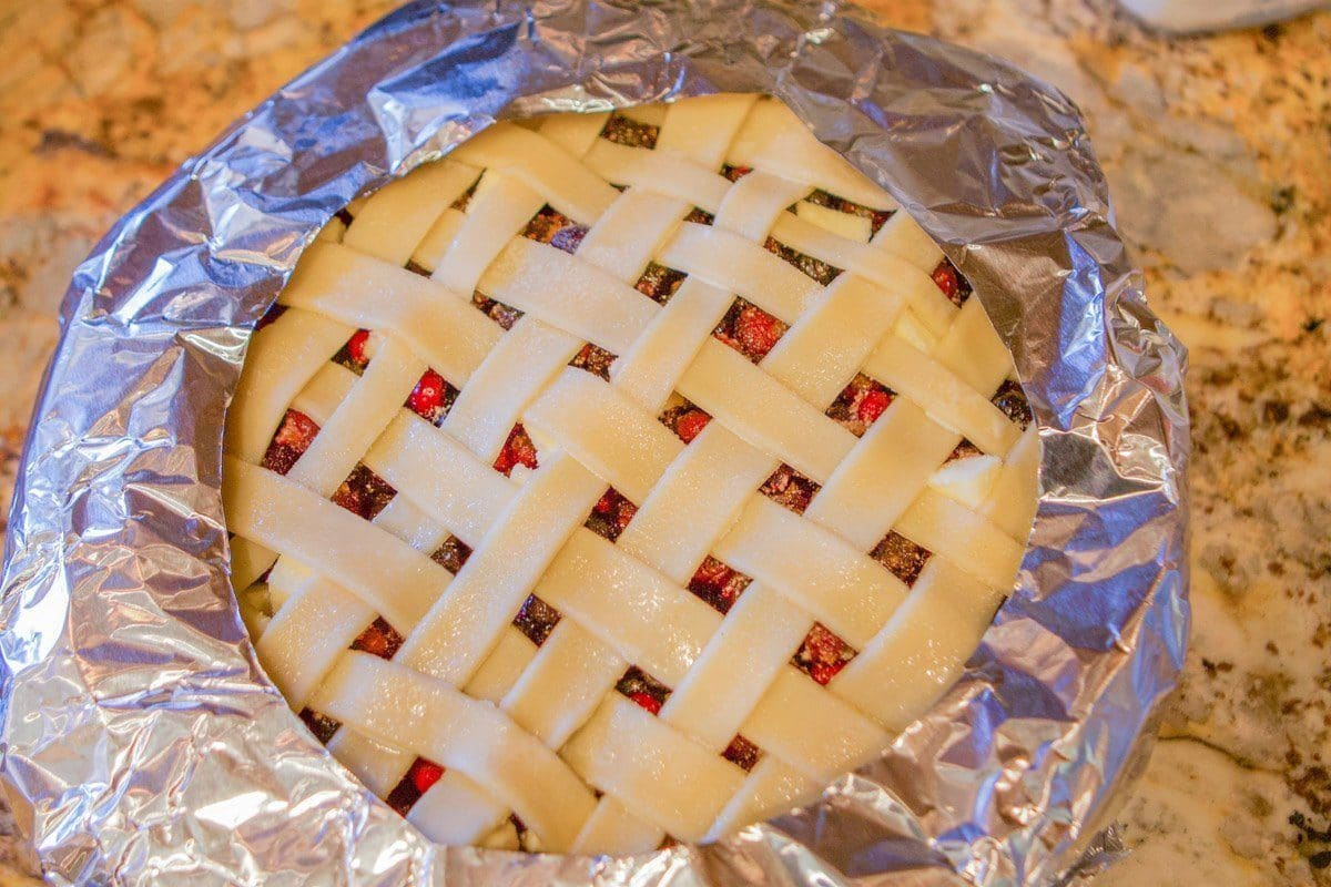 pie with lattice top edges covered with foil
