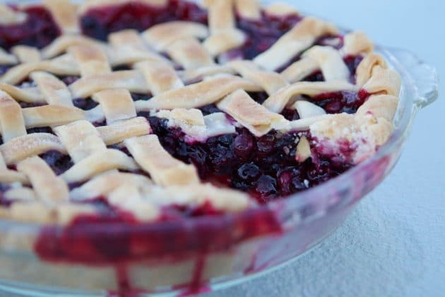 huckleberry pie with a slice missing