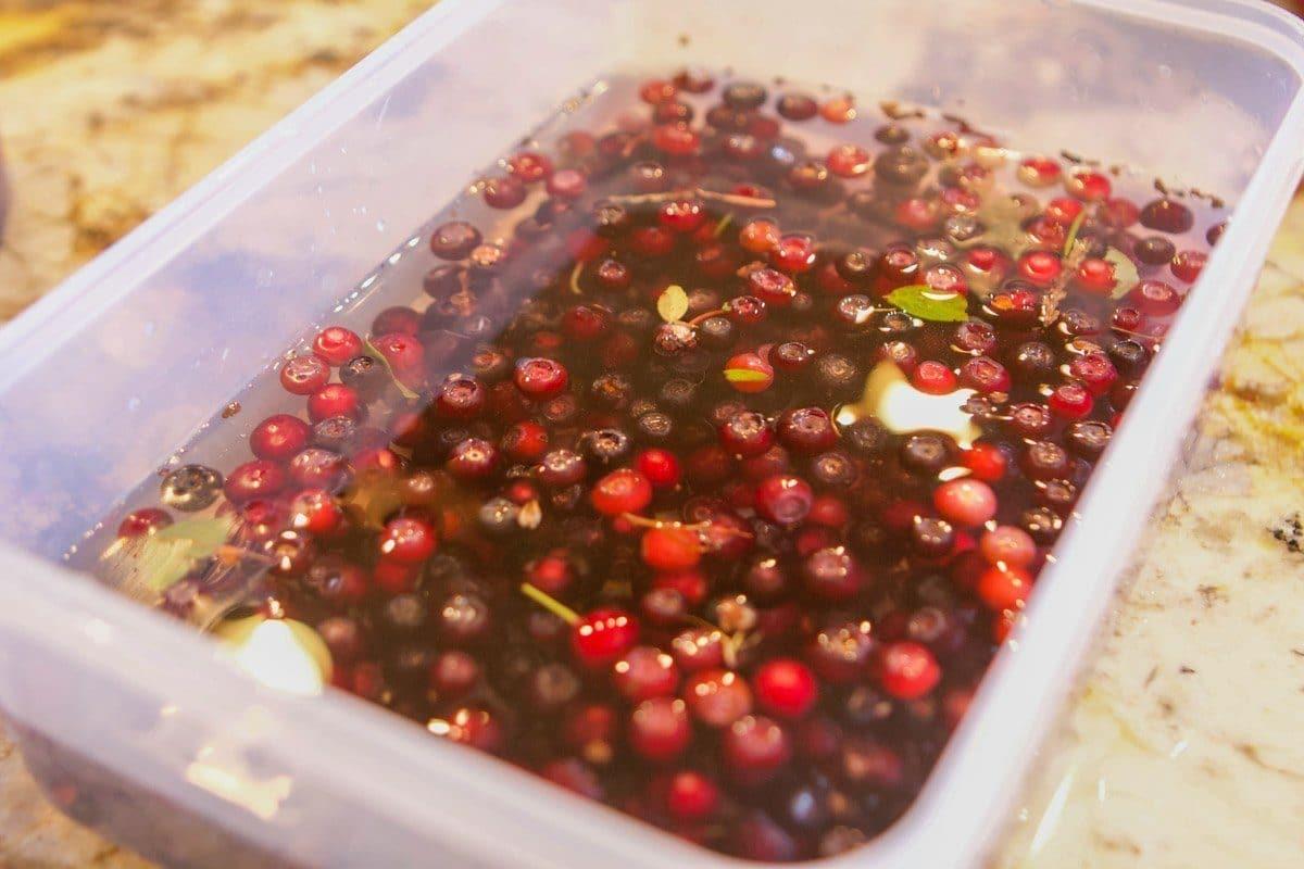 huckleberries in a Tupperware covered in water