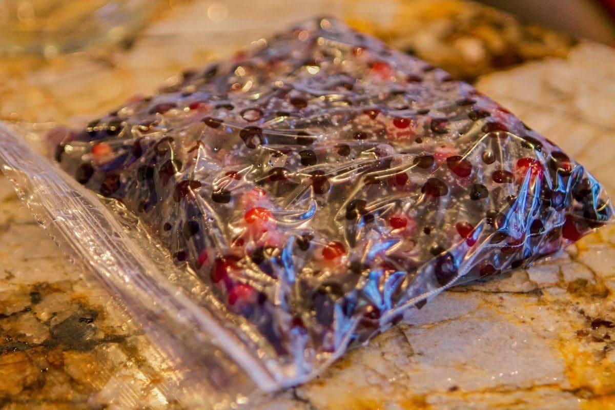 plastic sandwich bag full of huckleberries