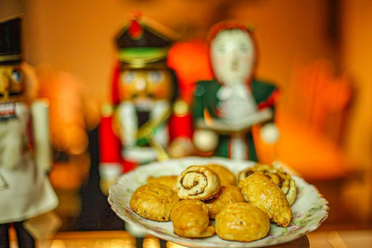 plate of Assyrian cookies with nut crackers in the background
