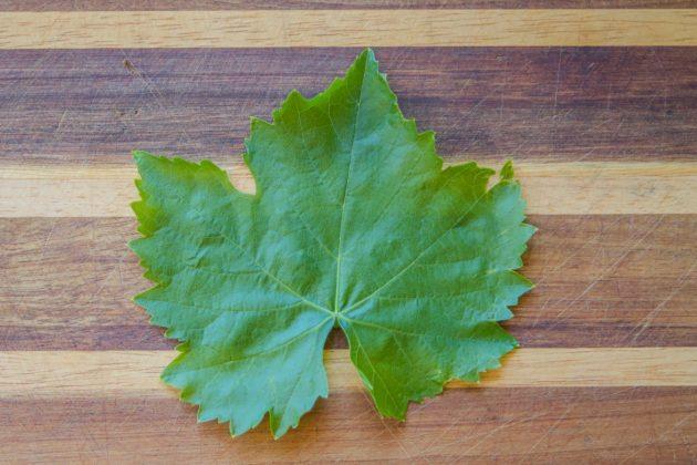 grape leaf on a cutting board