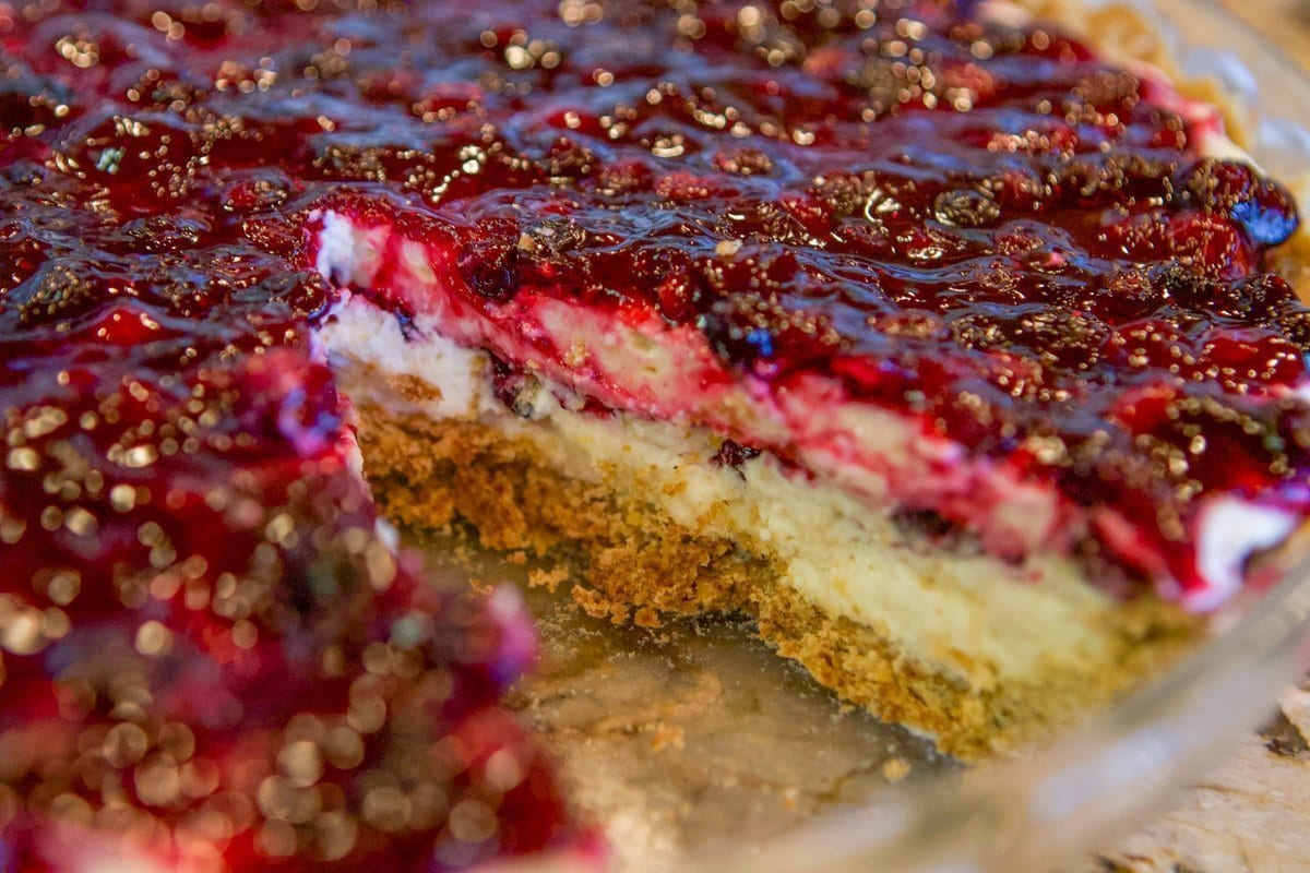 berry cheesecake with a slice missing