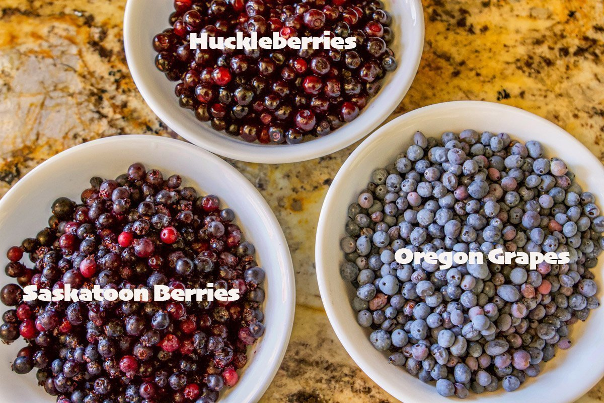 3 white bowls with berries