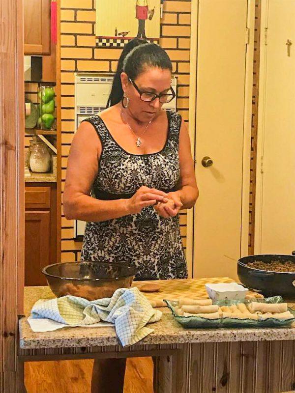 a lady making egg rolls