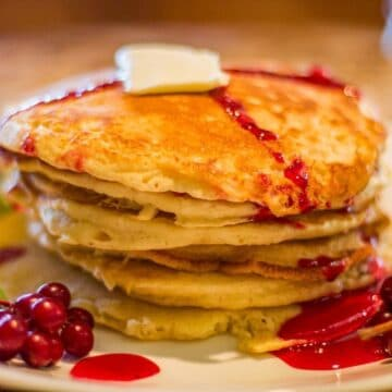 pancakes topped with chokecherry syrup and a dab of butter