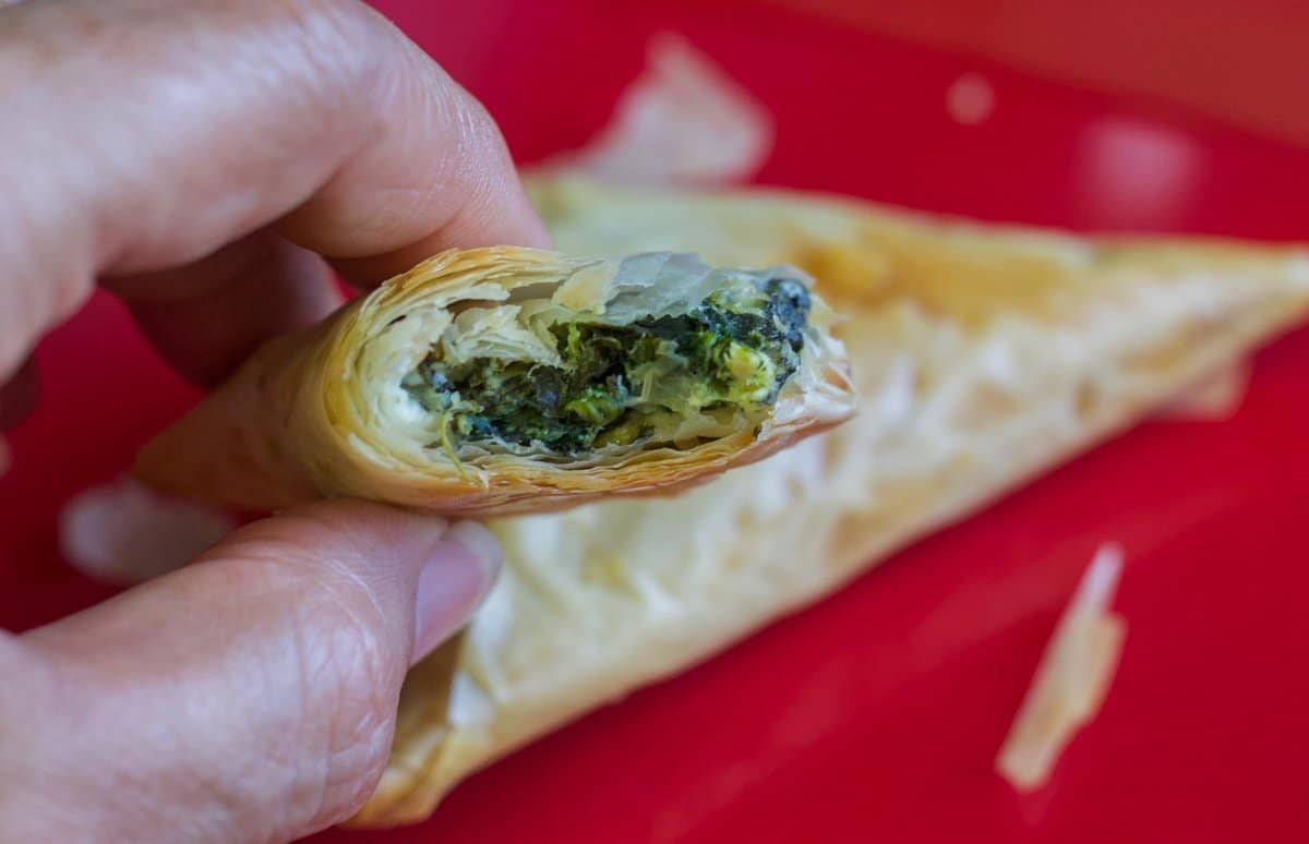 easy spanakopita with  bite taken out